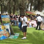 People come to shop and enjoy the fresh air. Image Credit: dubai-fleamarket.com