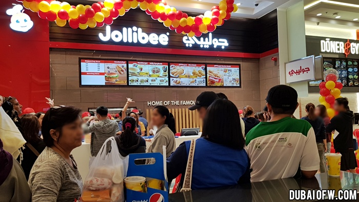 people lining up at Jollibee Ajman