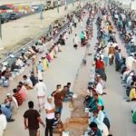 Dubai Police prepares 6km-long Iftar table for Workers