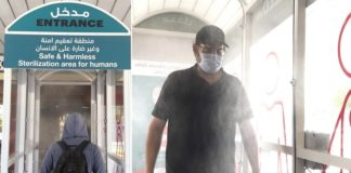 Passengers Get Sprayed at Disinfection Gate in Bus Station